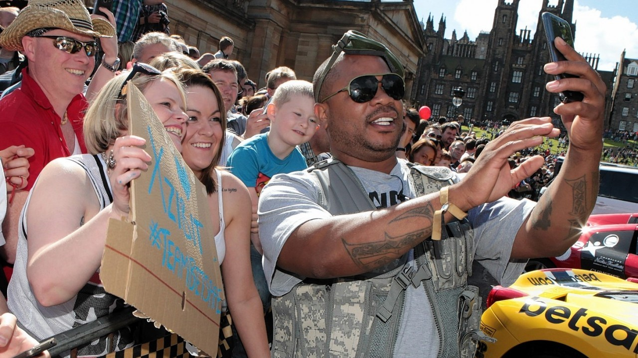 Rapper Xzibit takes a selfie with fans as he joins other supercar drivers as they set off from The Mound in Edinburgh and head to London on the next stage of the Gumball 3000.
