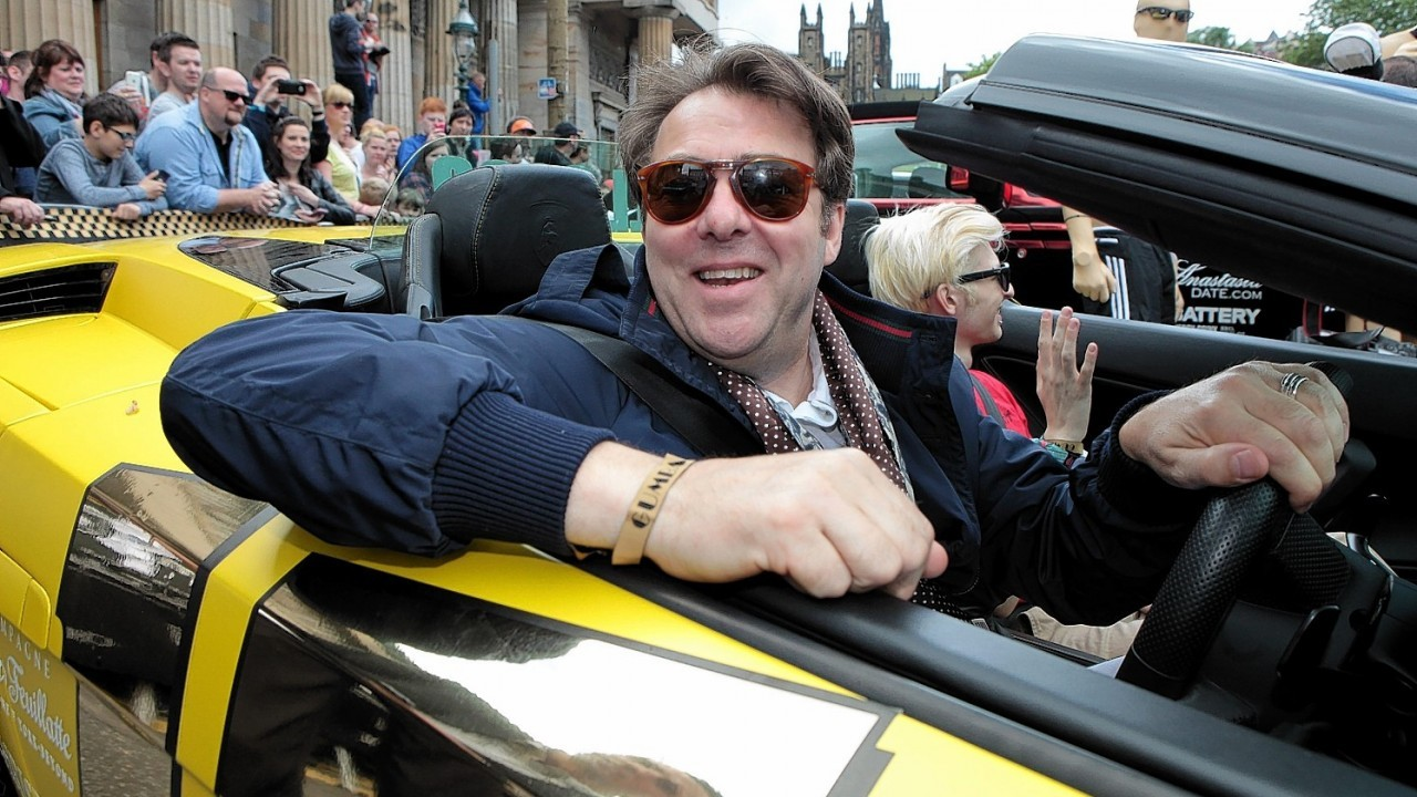 Jonathan Ross and his son Harvey in a yellow Lamborghini join other supercars as they set off from The Mound in Edinburgh and head to London on the next stage of the Gumball 3000.