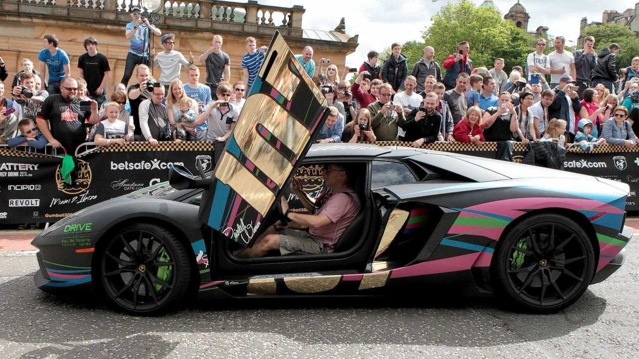 Hundreds of people turned out to watch dozens of supercars set off from The Mound in Edinburgh and head to London on the next stage of the Gumball 3000.