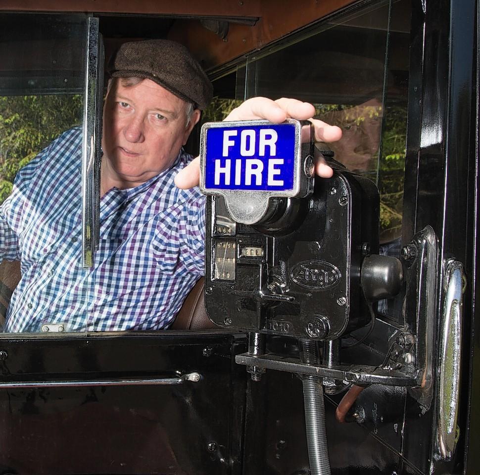 Bob Nye in his Hackney cab