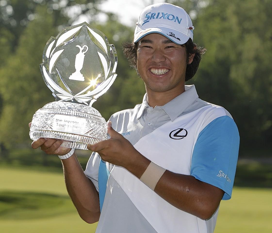 Hideki Matsuyama with the trophy
