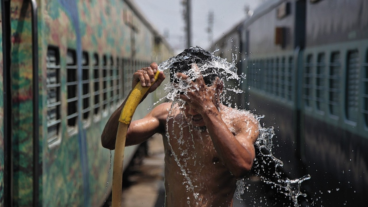 A strong heat has the northern plains of India in its grips with temperatures crossing 45 degree Celsius in several places. A man takes a shower at a railway station to cool himself down in Jammu.