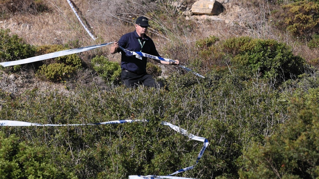 British police tape off an area of scrubland close to where Madeleine McCann went missing seven years ago, in the resort of Praia da Luz,