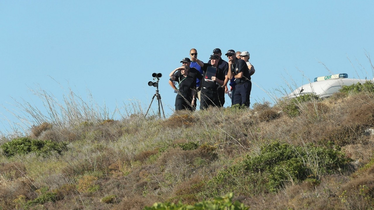British police search an area of scrubland close to where Madeleine McCann went missing seven years ago, in the resort of Praia da Luz, Portugal
