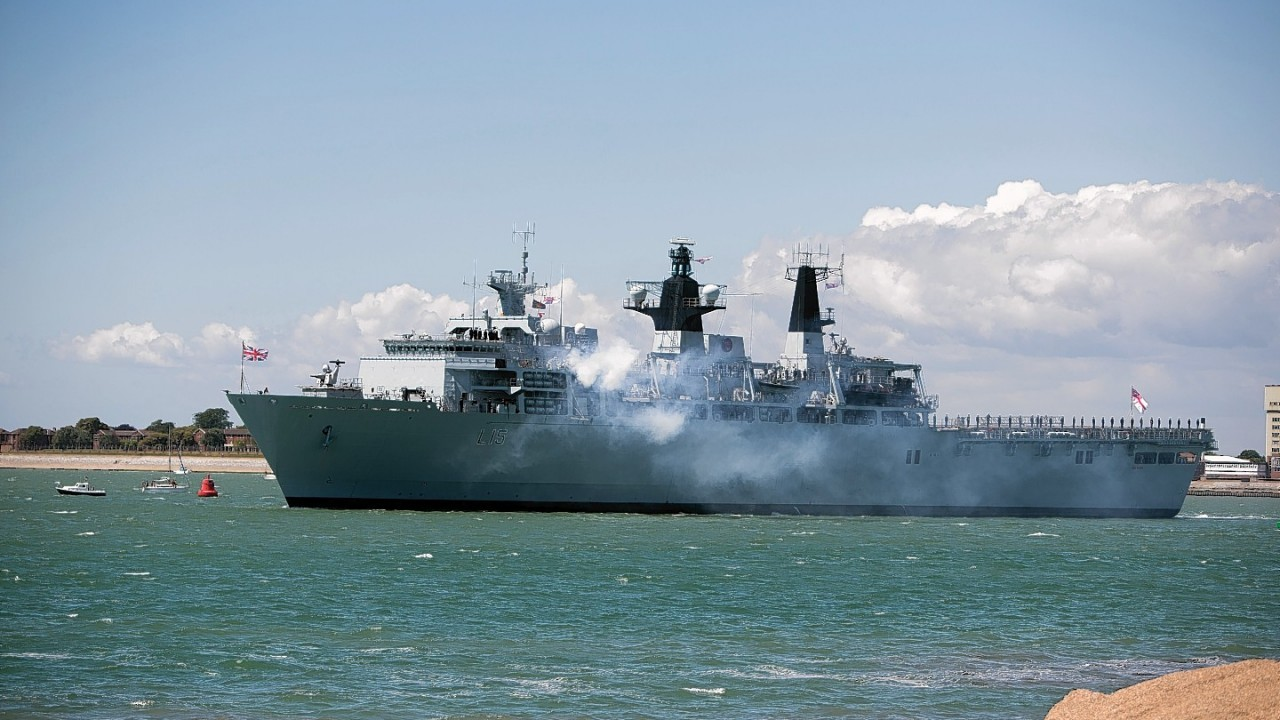 HMS Bulwark performs a gun salute as it leaves harbour near Southsea Common in Hampshire to mark the 70th Anniversary of the D-Day landings.