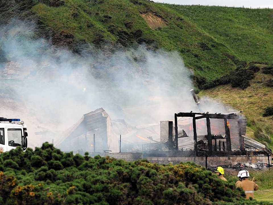 Firefighters have returned to the scene of a fire which destroyed a Moray golf course last night