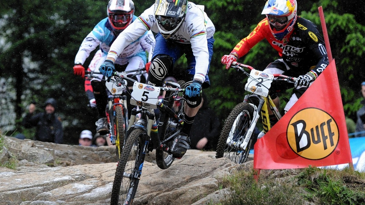 J-GL-070614-01-020.jpg Caption: World Mountain Bike Downhill Championship 2014 at Fort William. 4X Protour Four Cross Men's Final with Joost Wichman, NED,centre, leading eventual winner, Tomas Slavik, CZE, right, and Quentin Derbier, FRA, left.