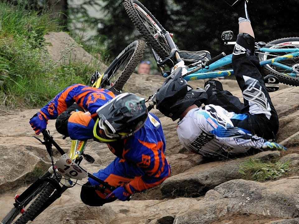 World Mountain Bike Downhill Championship 2014 at Fort William. 4X Protour Four Cross Men's competition. Two riders crah after colliding in their heat.
