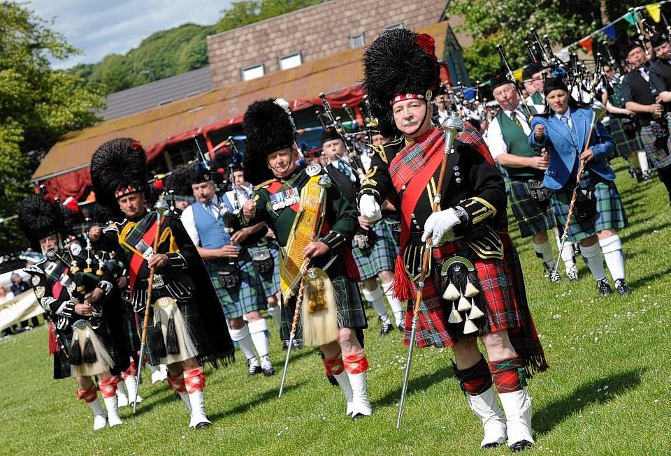 Massed pipe bands at Oldmeldrum Sports and Highland Games