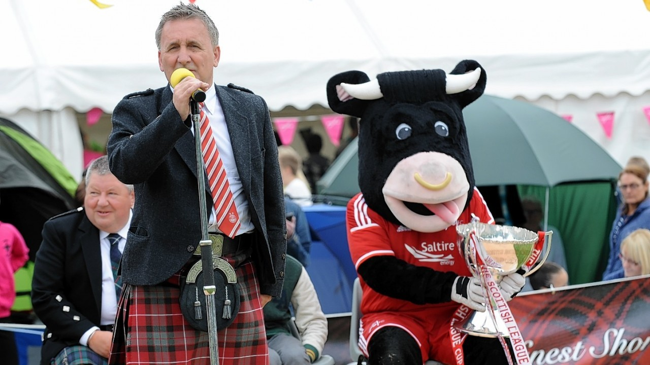 Angus the bull with George Yule. Credit: Kenny Elrick.
