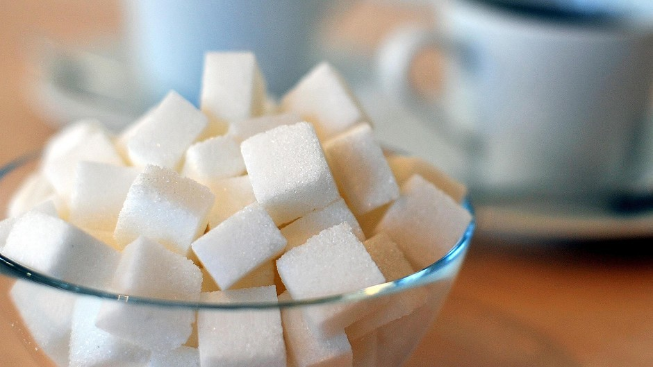 """The amount """"free sugar"""" contributes to dietary calories should be slashed by half, according to scientists advising the Government"""