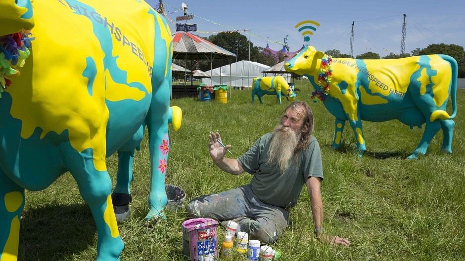 Life-size fibreglass cows decorated by artist Hank Kruger, modelled on Worthy Farm's famous dairy herd, which have been converted into 4G wifi hotspots to benefit festival goers at this year's Glastonbury.