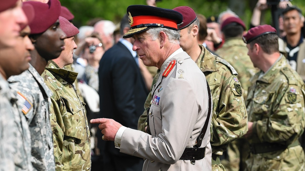The Prince of Wales meets British and American paratroopers during a reception in Breville Les Monts, Normandy