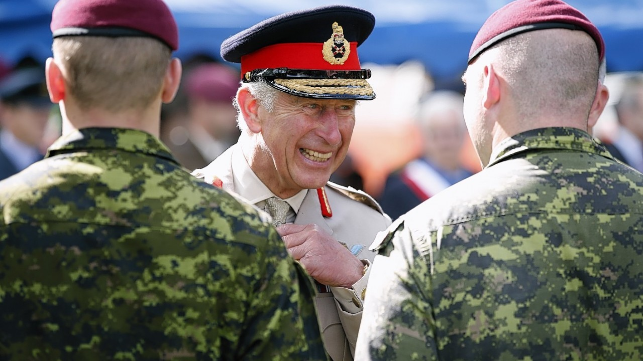 The Prince of Wales greets current  members of the Canadian Parachute Corps after a service of remembrance at the Third Parachute Brigade and Canadian Parachute Corps Memorial, Le Mesnil Bavent, Normandy