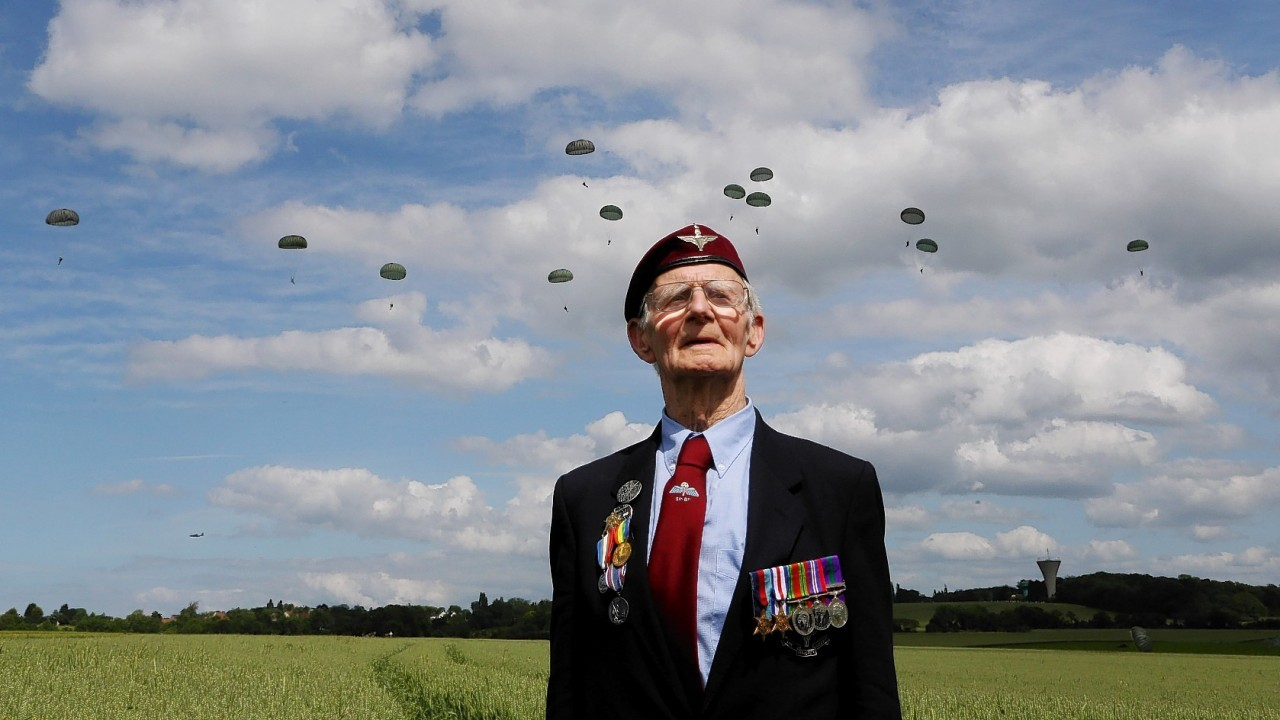 A commemorative parachute drop takes place over wartime Drop Zone N in Ranville, Normandy.