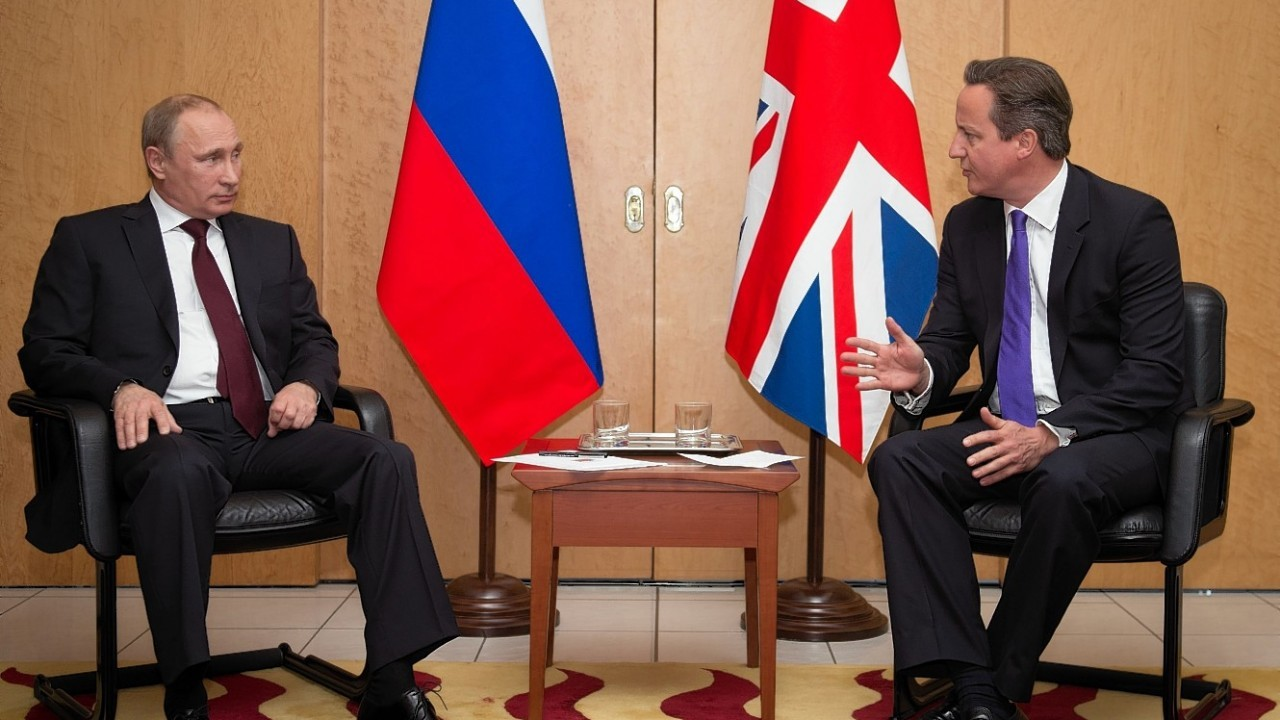 British Prime Minister David Cameron meets with Russian President Vladimir Putin (left) at Charles De Gaulle Airport in Paris, as they travelled to France ahead of the 70th anniversary D-Day commemorations