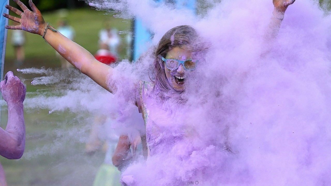 Participants take part in the Color Me Rad 5km run at Ingleston in Edinburgh where the runners are blasted with bombs of different colours during the race.