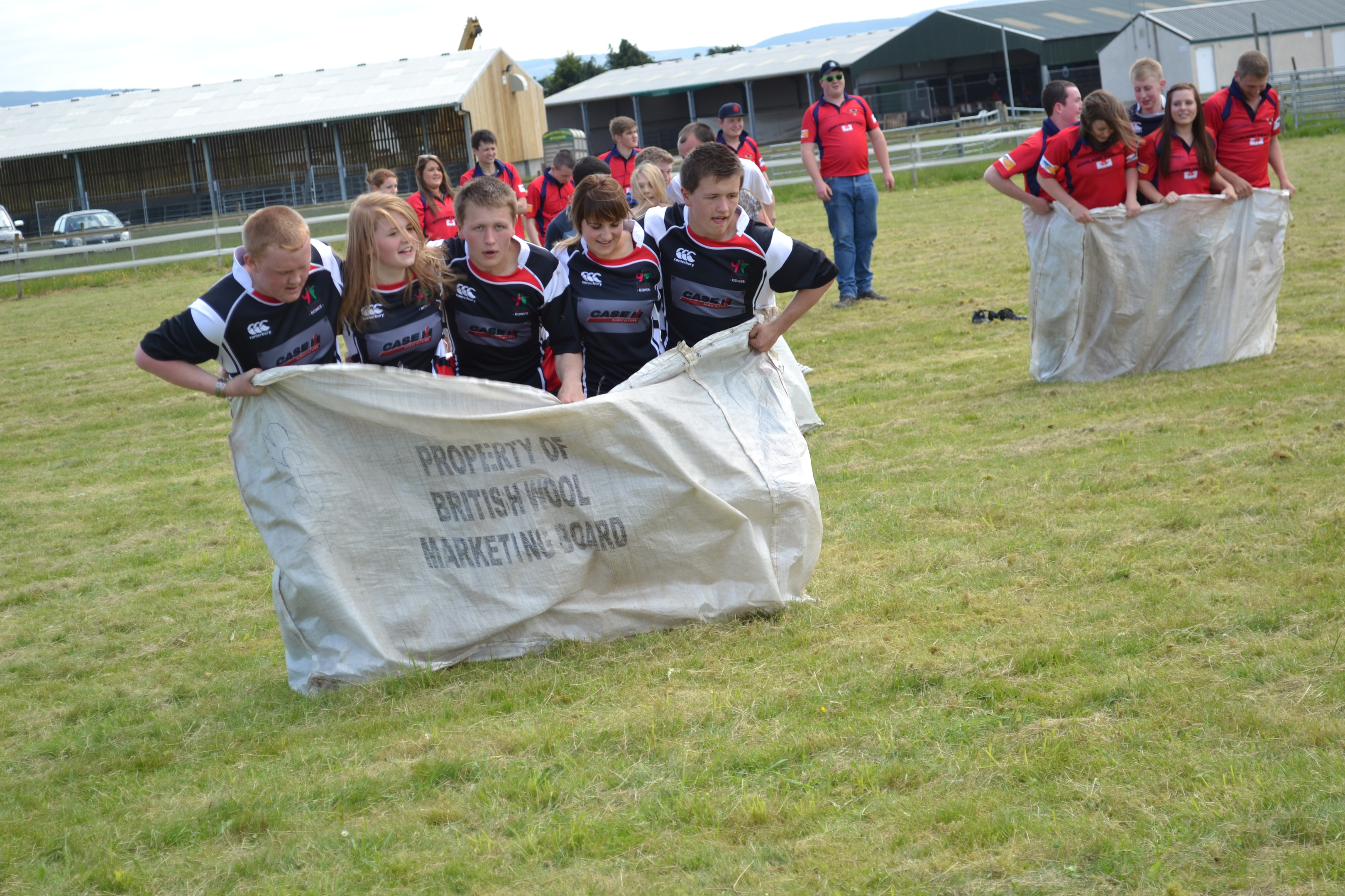 Young farmers compete in the wool bag race at the Highland Rally