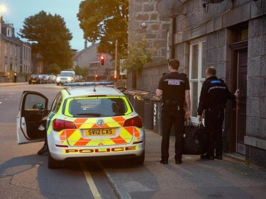 Armed police outside the home in Aberdeen