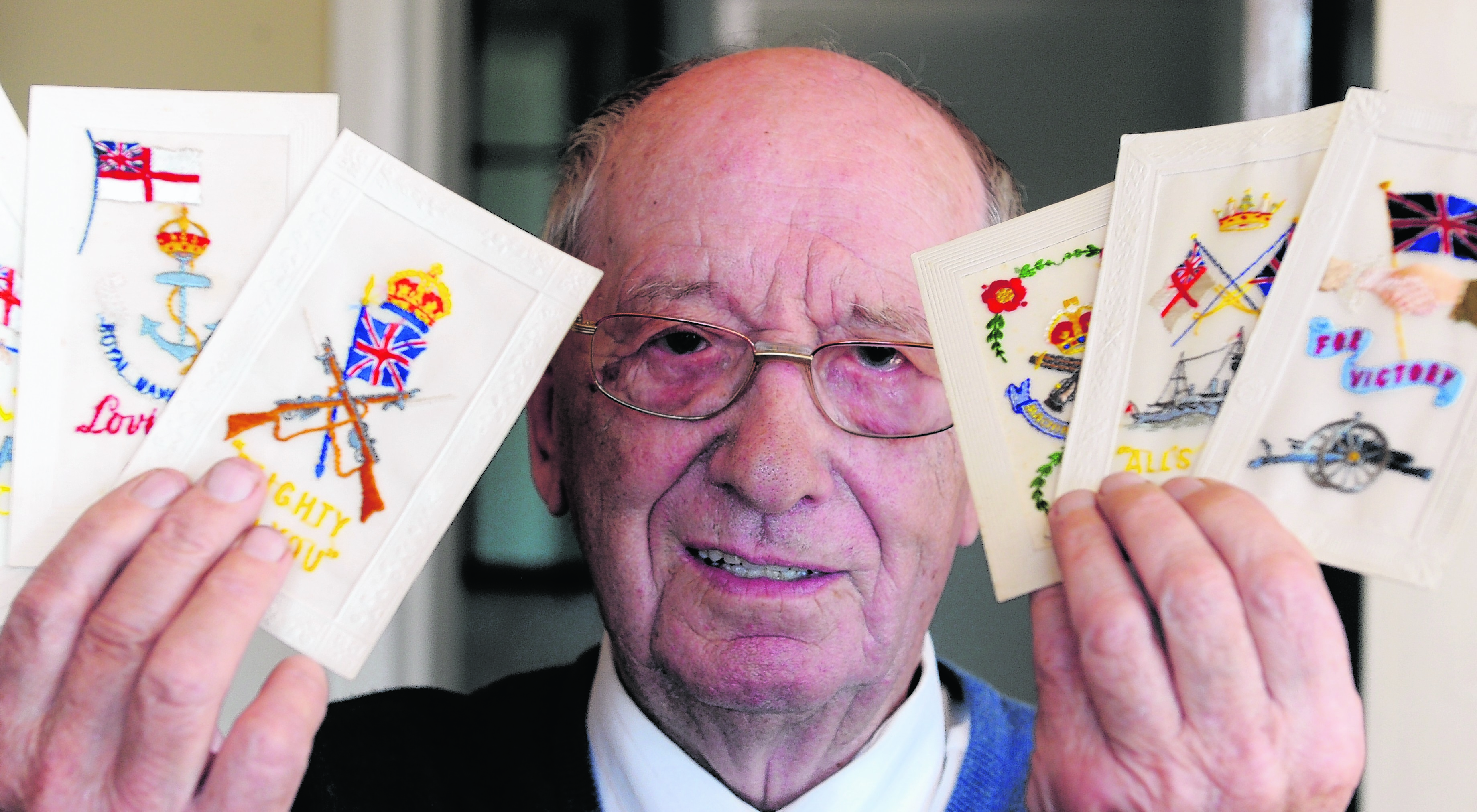 Eric Martin with his World War I greetings cards.