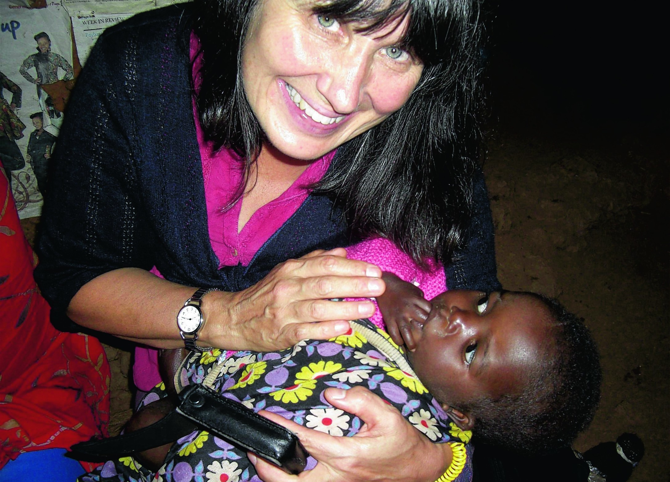 Aberdeen University graduate Dr Susan Wilson MBE with young orphan Jaffary