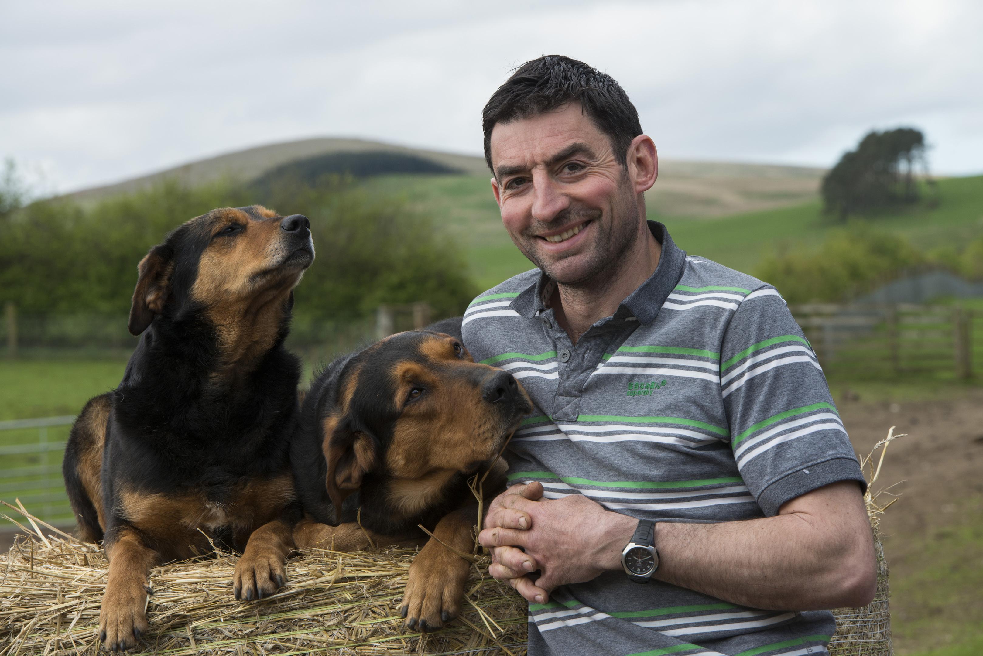 Jess and son Doug with farmer Hamish Dykes.