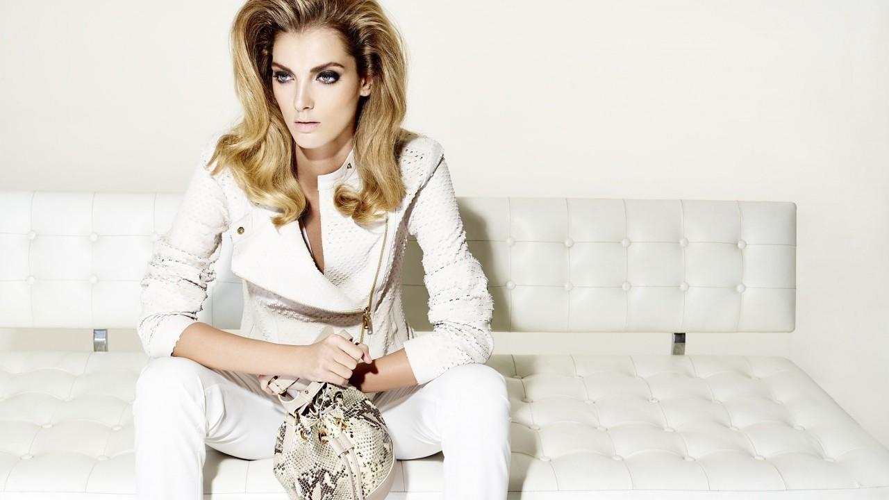 Cameron leather jacket £449 Tipsy snake print leather bag £359 both Desa