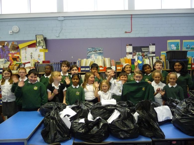 Cornhill Primary School pupils with their black bin bags full of school jumpers for Nepalese kids