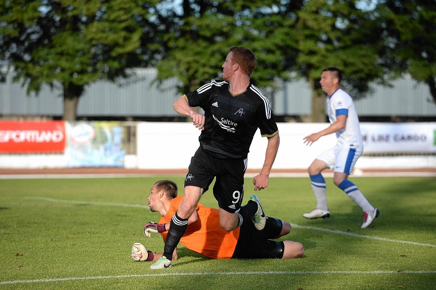 Adam Rooney scores in Riga