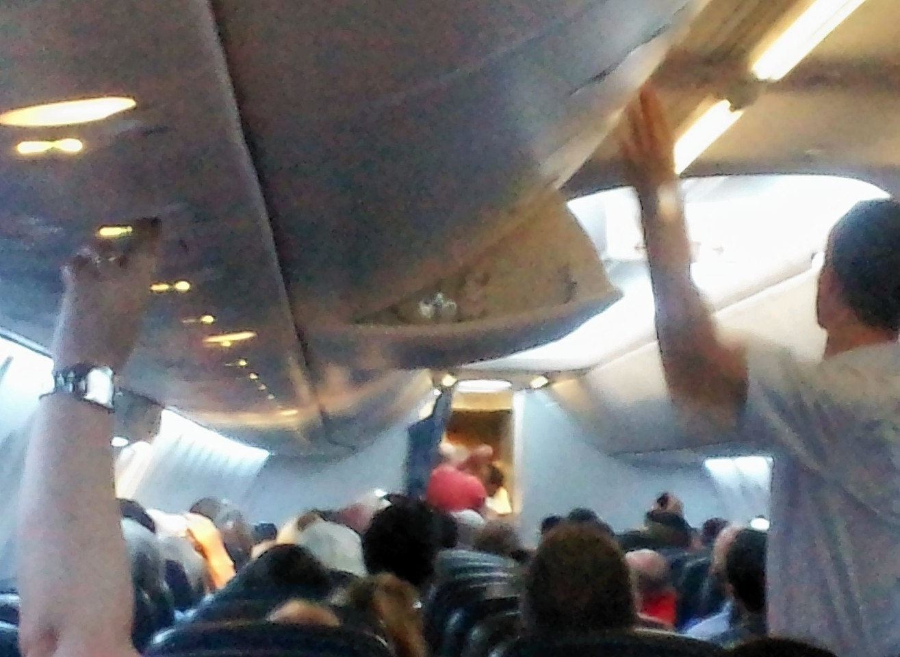 Police enter the aircraft after it was diverted to London