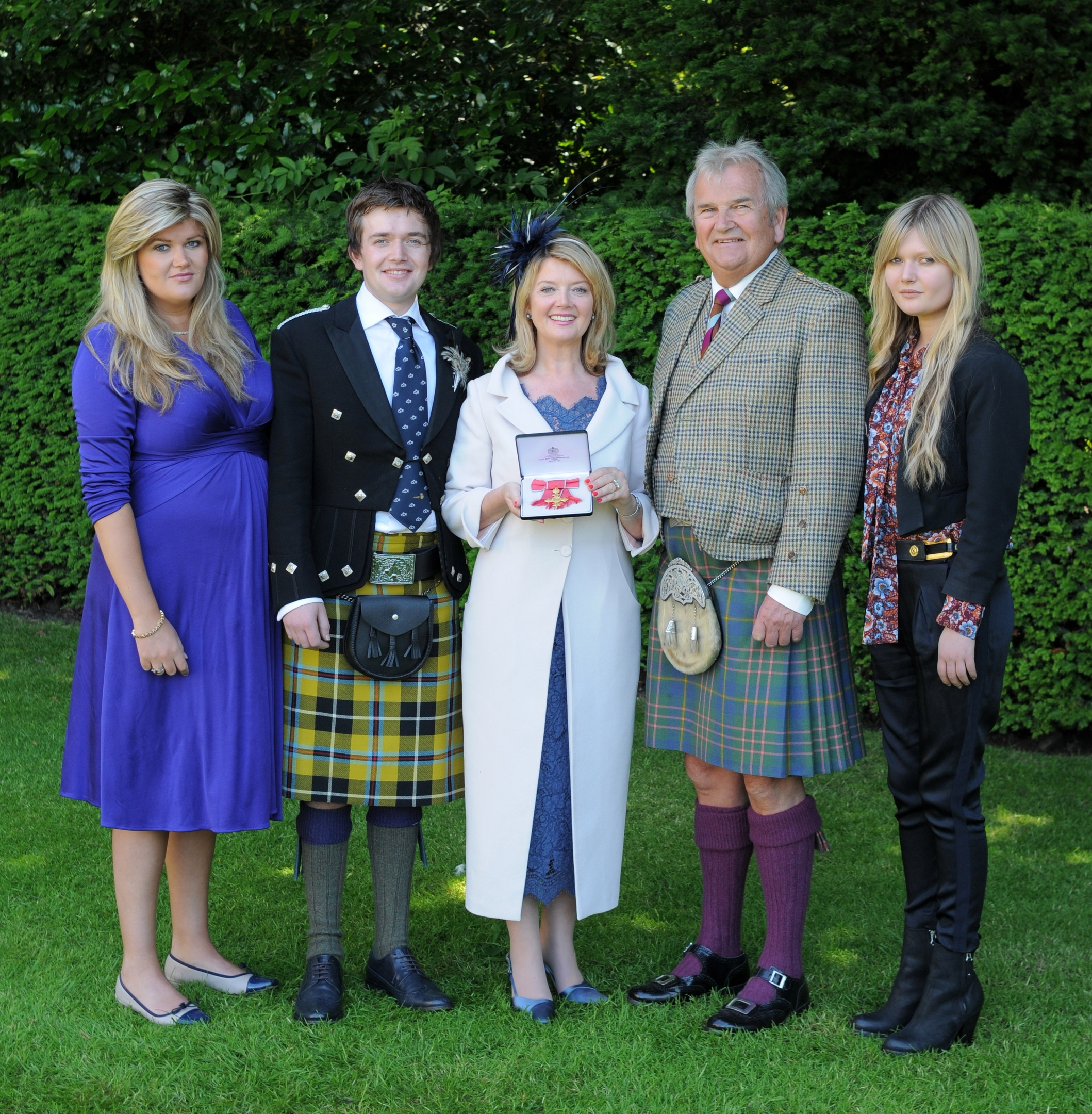 Dr Fiona Kennedy, pictured with her family after she received her OBE from Queen Elizabeth II at the Palace of Holyroodhouse in Edinburgh. OBE. Picture date: Tuesday 1 July 2014. Copyright: Palace Photos