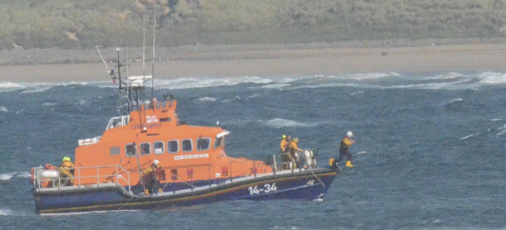 Volunteer crew members jumps in to save child