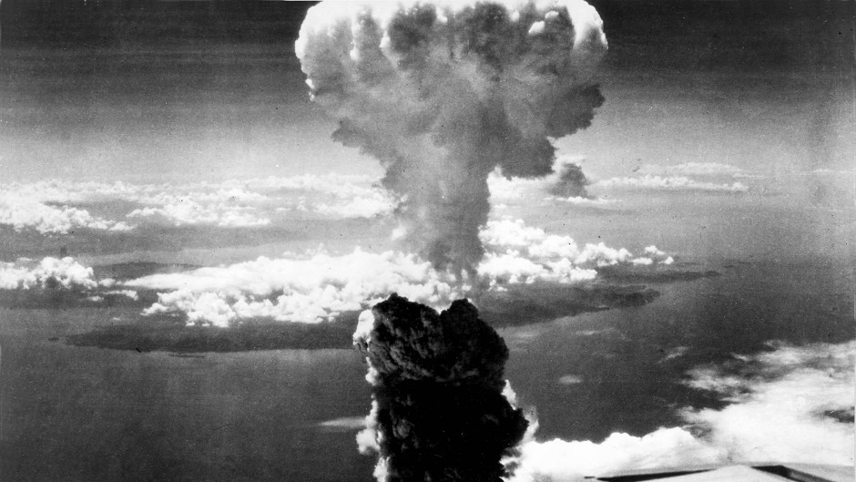A mushroom cloud towers over Nagasaki, after the atomic bombing on August 9 1945.