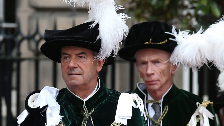 The Earl of Home and Lord Smith of Kelvin, left, attend the Thistle service at St Giles' Cathedral in Edinburgh where they were installed as Knights of the Thistle