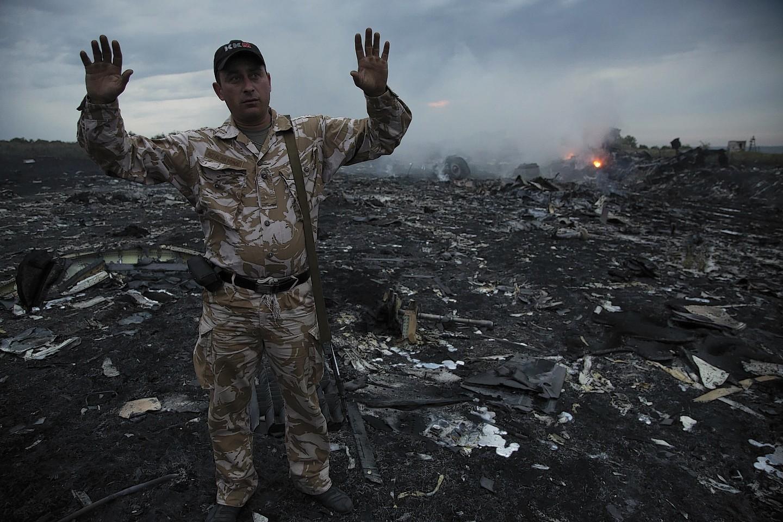 Smoke rises up at a crash site of a passenger plane, near the village of Grabovo, Ukraine (AP)