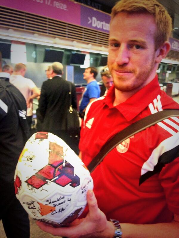 Adam Rooney with the match ball at Riga Airport