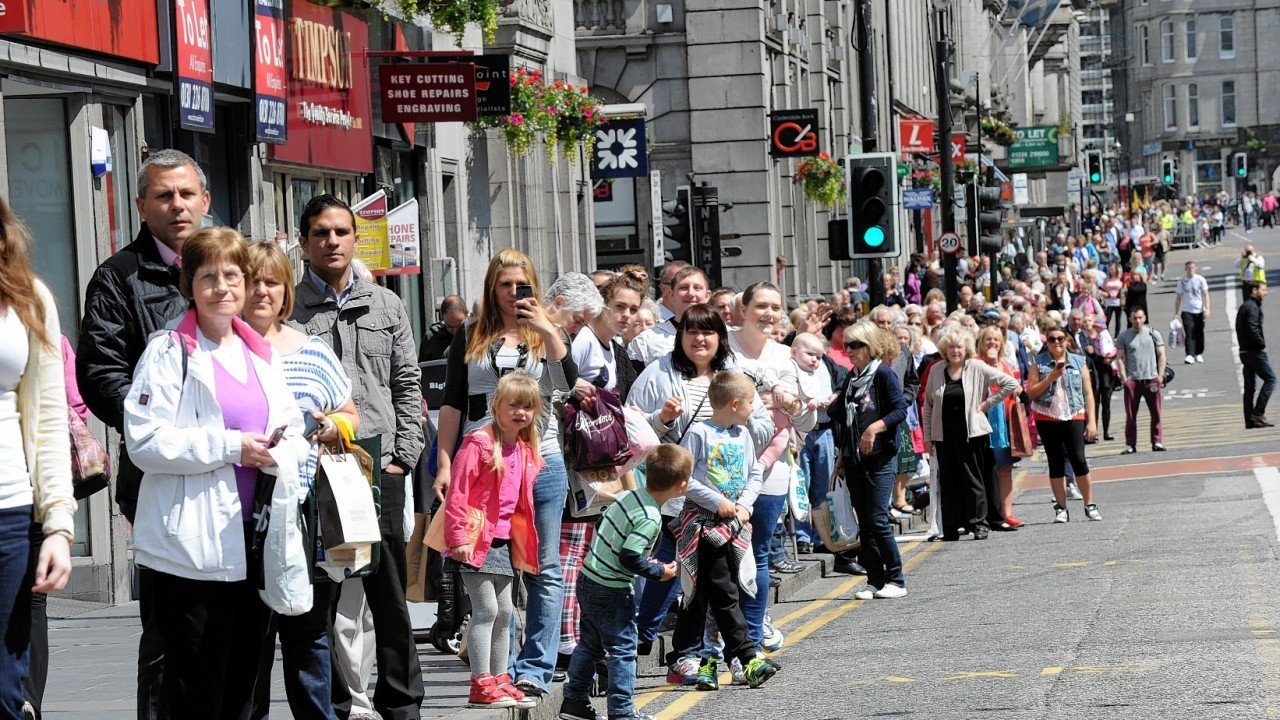 Crowds watch the march at Union Street