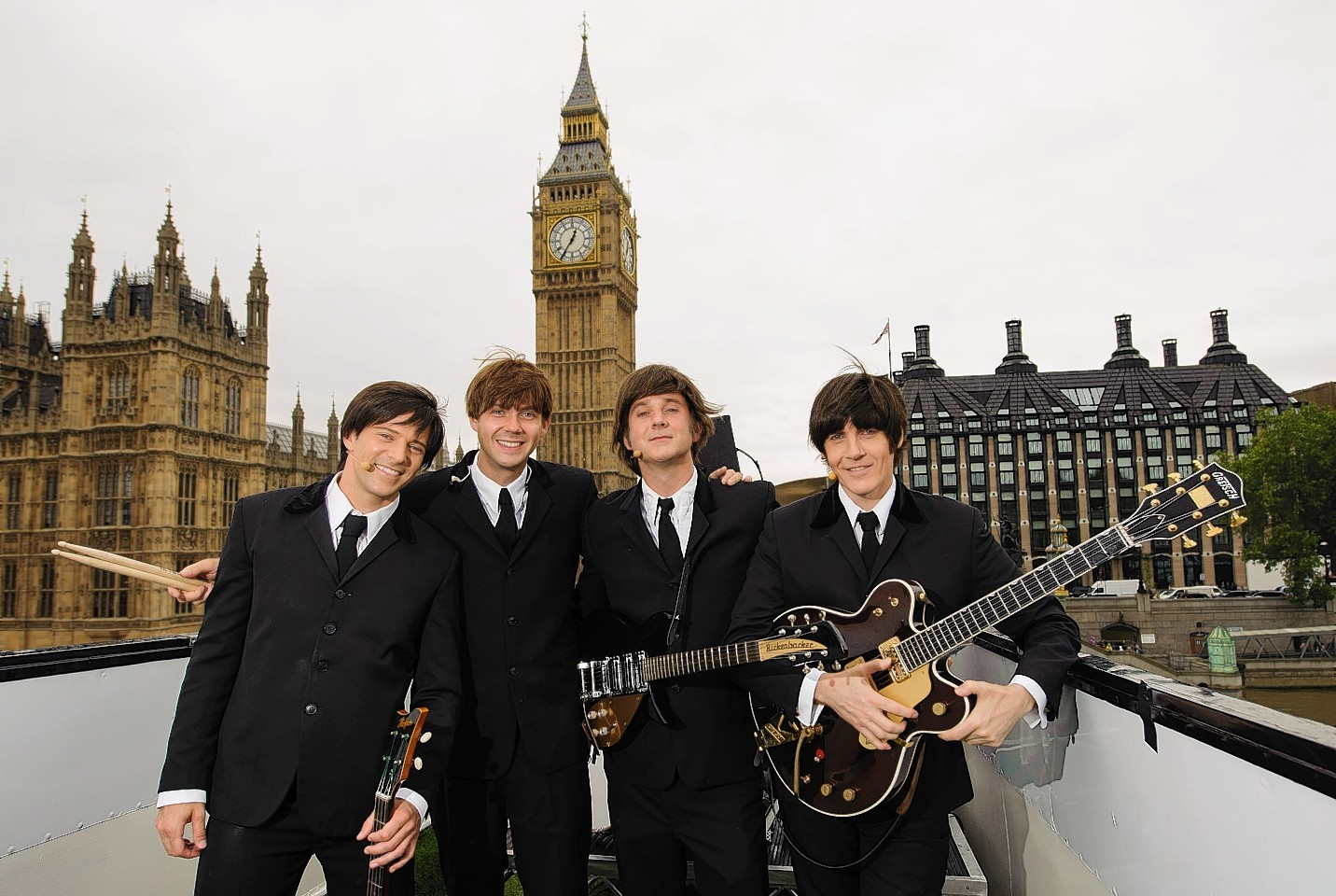 The cast of Beatles musical Let it Be perform in iconic locations to mark the show's return to Garrick Theatre.