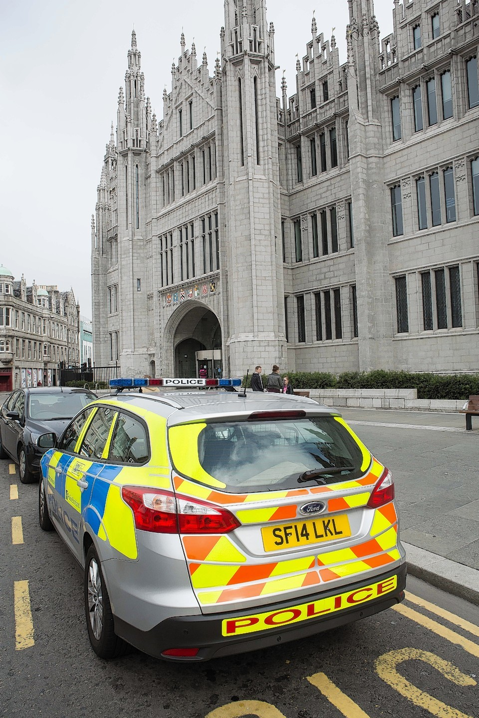 Police outside Marischal College after the incident in the Council's reception