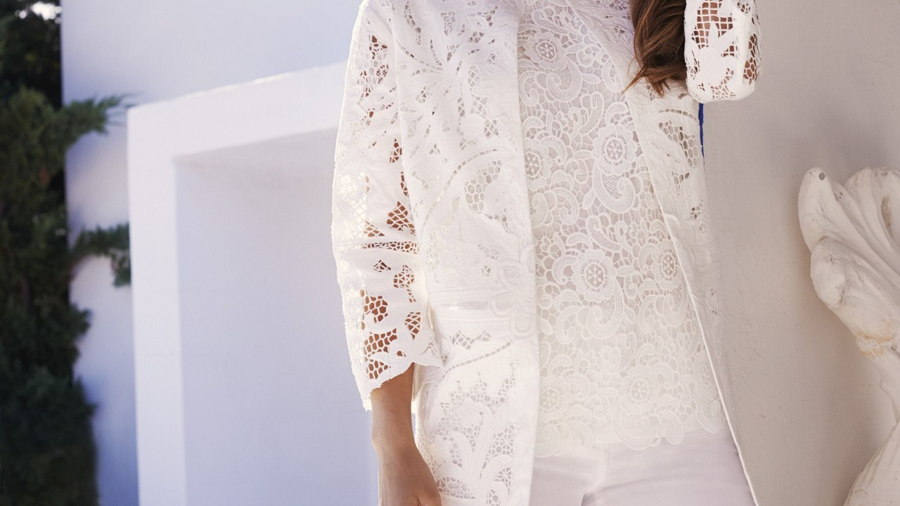 Cutwork lace coat £350, lace top £32, white jeans £55, all East