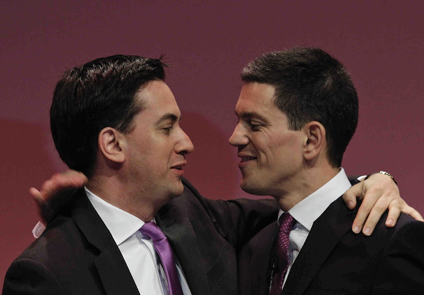David Miliband, right, embraces his brother, Ed, at a Labour Party conference