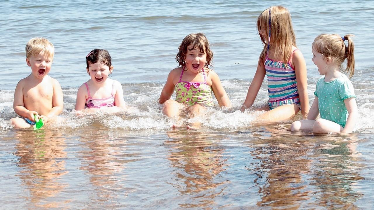 People enjoy a bright sunny day on Portobello beach near Edinburgh. July 22 2014