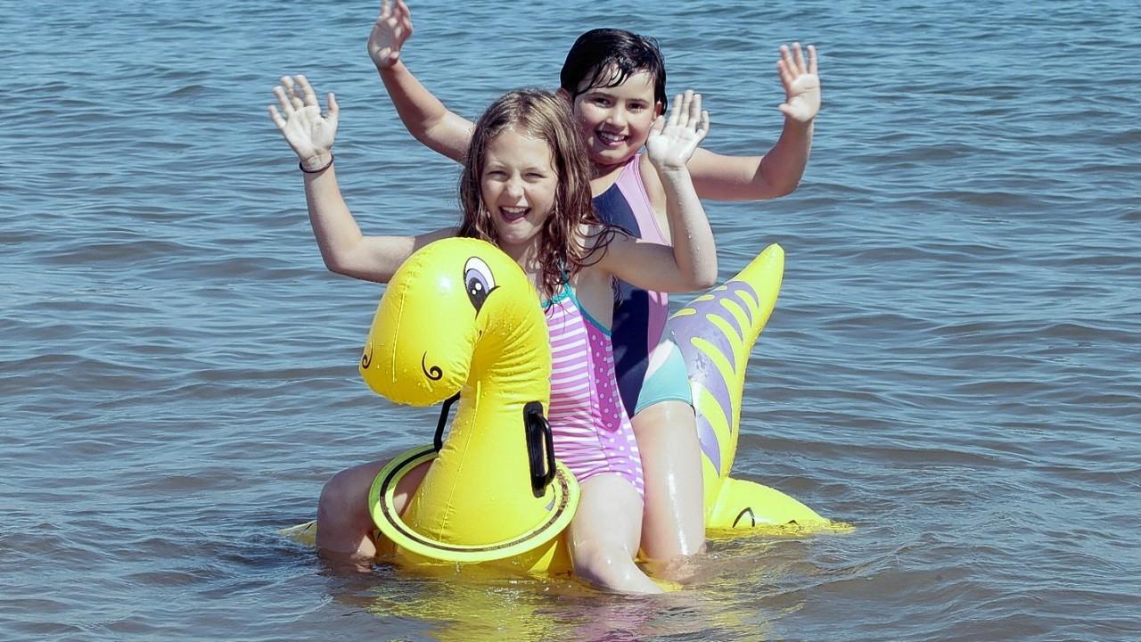 People enjoy a bright sunny day on Portobello beach near Edinburgh.