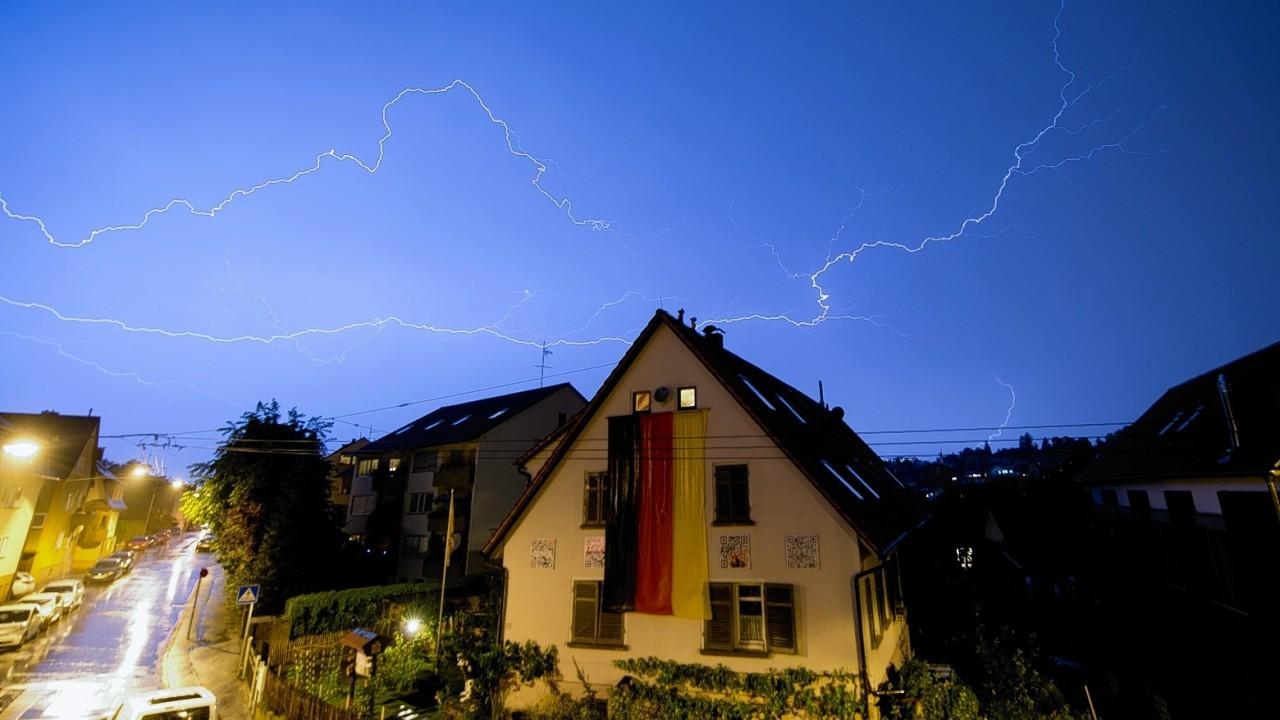 Lightning flashes over the city of Stuttgart, Germany, Monday, July 7, 2014