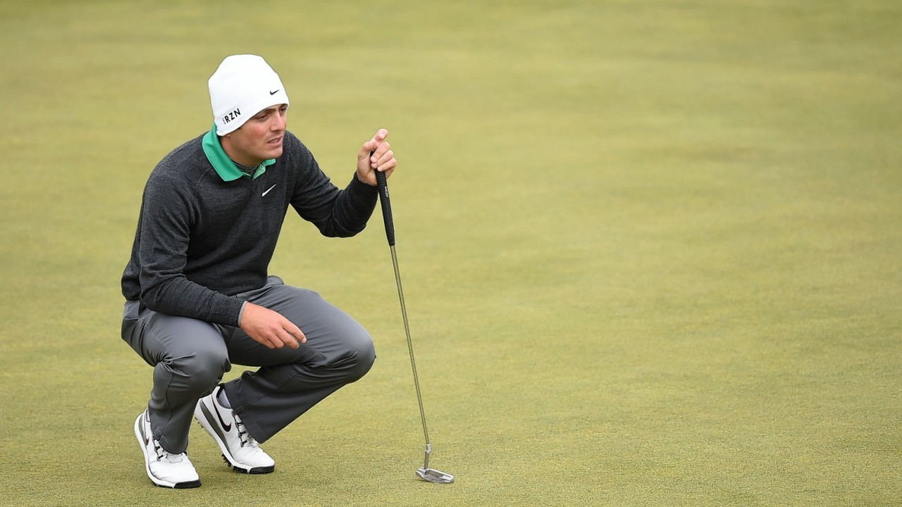 Italian star Francesco Molinari lines up a putt