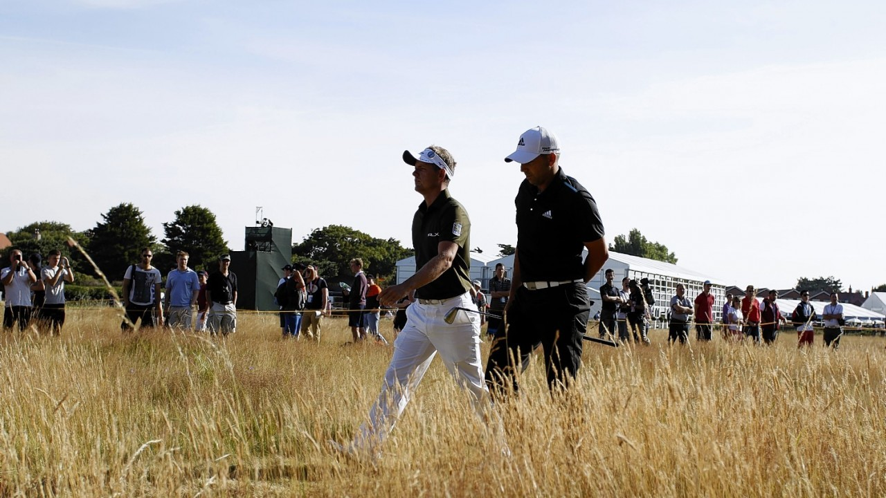 England's Luke Donald and Spain's Sergio Garcia walk up the 1st during day one of the 2014 Open Championship at Royal Liverpool Golf Club, Hoylake