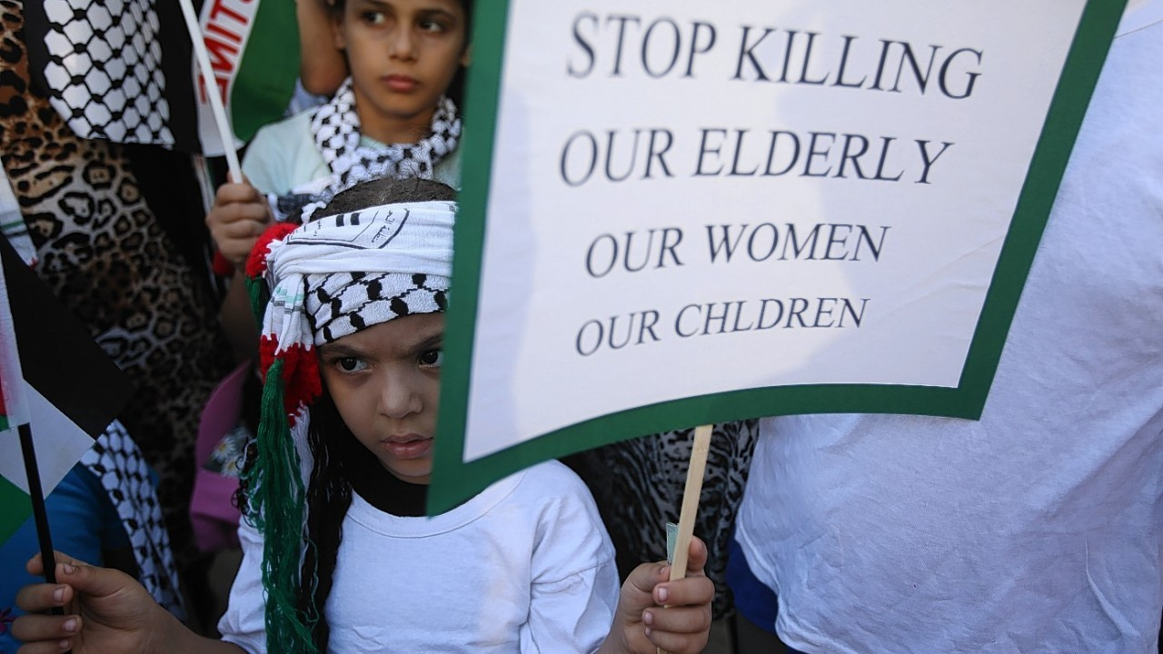 Demonstrators hold up placards during a protest against the war in Gaza, in Beirut, Lebanon, Monday July 21, 2014