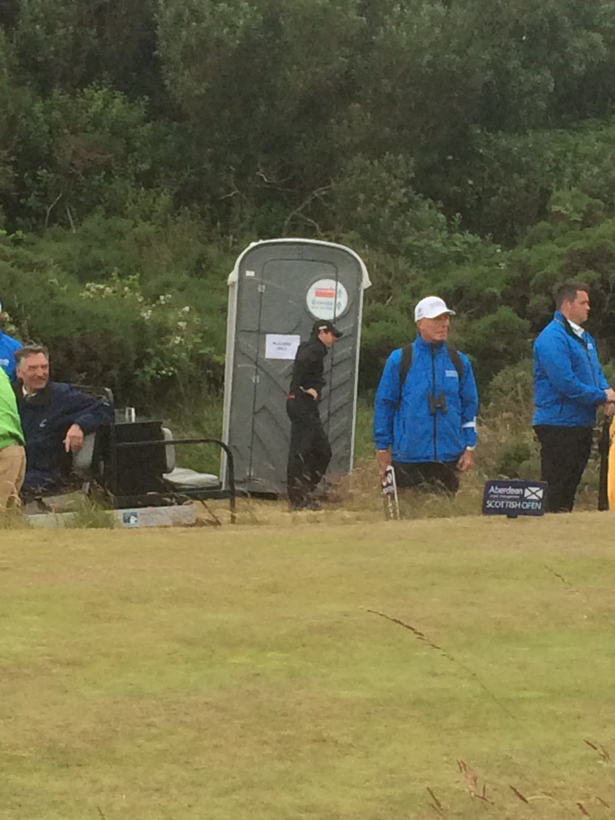 Rory McIlroy locks his playing partner in a portable toilet