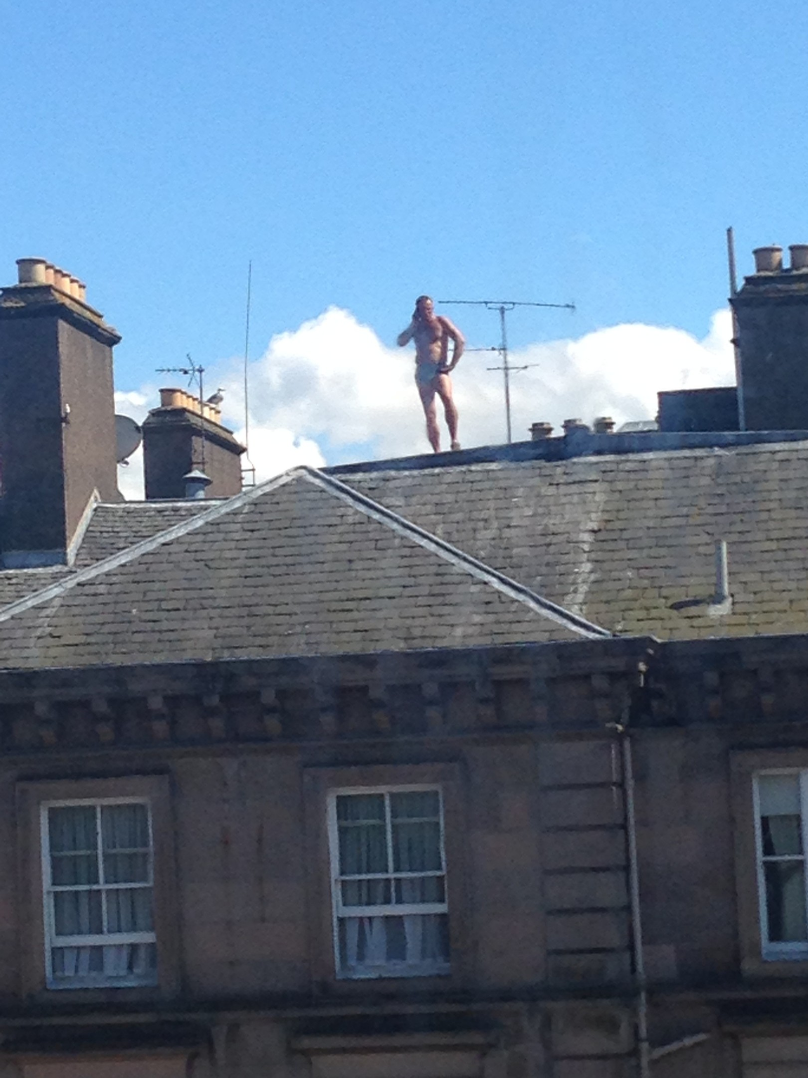 A man in his underpants on top of the Inverness Royal Highland Hotel