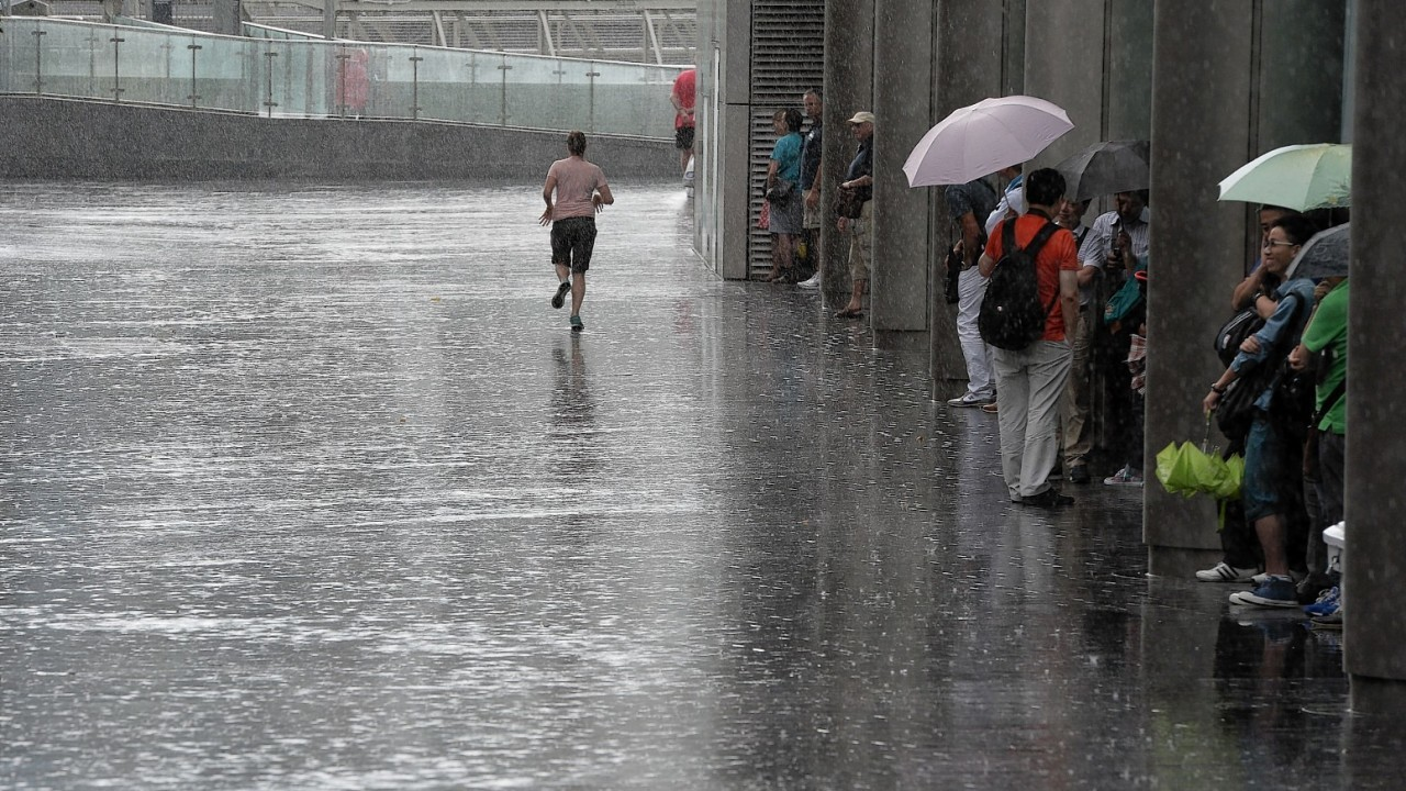 Members of the public get soaked as heavy rain falls in the City of London, London